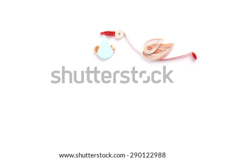 Quilling. Ribbon stork flying with child on a light background - stock photo