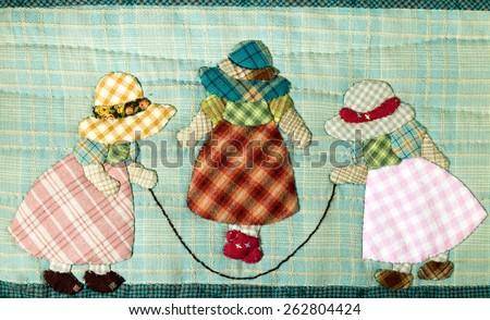 Quilt : Girls skipping rope - stock photo