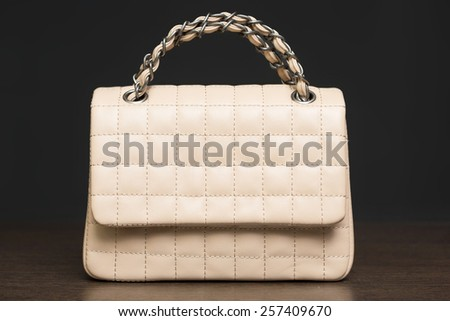 quilted bag on the shelf in the store - stock photo