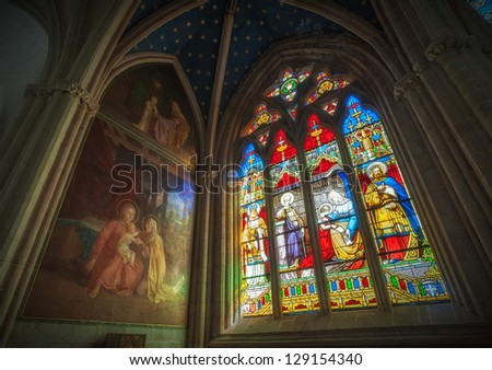 QUIMPER, FRANCE - AUGUST 31: Stained glass and canvas in the chapel of Cathedrale Saint-Corentin de Quimper. This is the is the seat of the Bishops of Quimper-Leon. Brittany, France on August 31, 2011 - stock photo