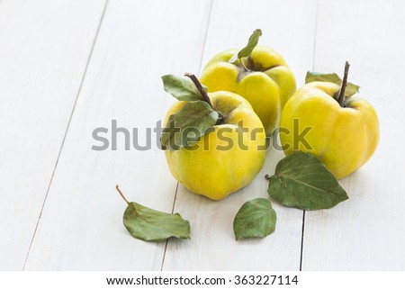 Quince fruits on a white wooden background. Quince fruits. - stock photo