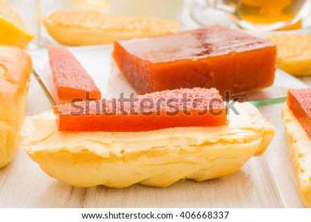 quince jelly on butter, spread on milk bread