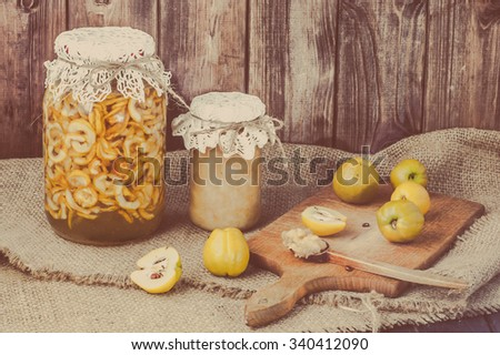 Quince preserves in a wooden pantry. - stock photo