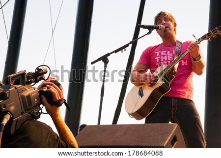 QUINCY, WA - JULY 26, 2006: Jeremy Camp plays guitar and sings at Creation NW, a 4 day Christian concert festival at the Gorge Ampitheater in Washington.