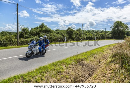 QUINEVILLE,FRANCE - JUL 2: Medical bike driving on the road during the first stage of Tour de France in Quineville, France on July 2, 2016.