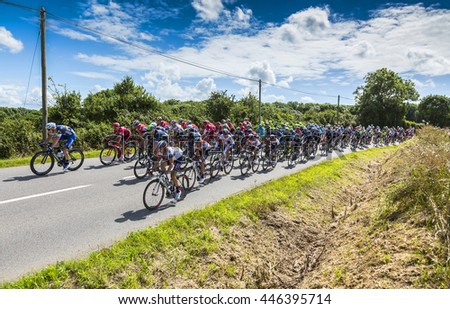 QUINEVILLE,FRANCE - JUL 2:The peloton riding during the first stage of Tour de France in Quineville, France on July 2, 2016.