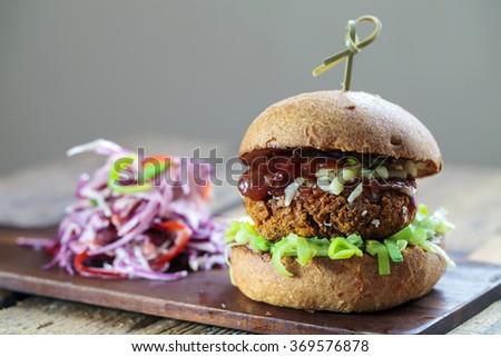 Quinoa and butternut squash burger in brioche bun - stock photo