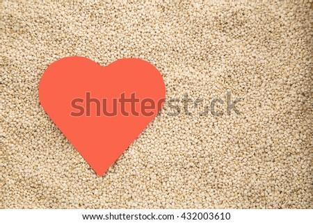 Quinoa grains on wooden background - stock photo