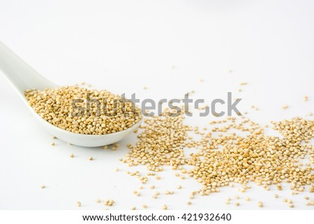 Quinoa in a spoon isolated on white background  - stock photo