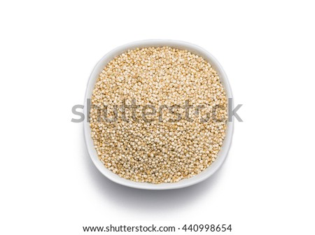 Quinoa in white bowl isolated on white background, view from above. - stock photo