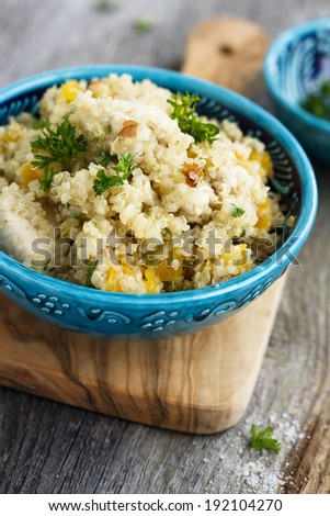 Quinoa pilaf with almond and dried apricots - stock photo