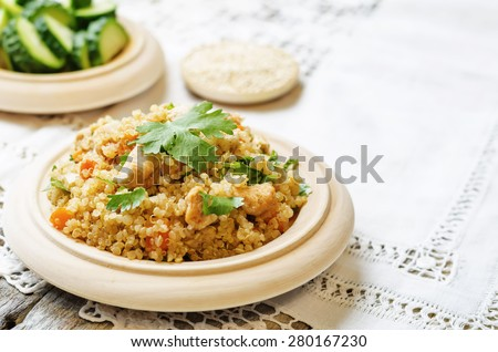 quinoa pilaf with chicken and vegetables. the toning. selective focus - stock photo