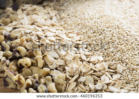 Quinoa, rolled oats and chopped walnuts for baking