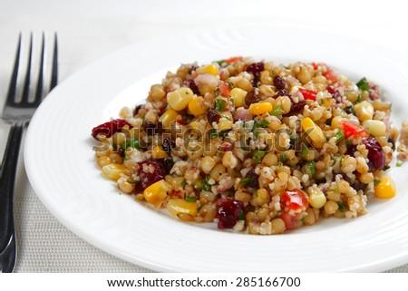 Quinoa salad on white background, shallow focus - stock photo