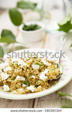 Quinoa salad with parsley and cheese - stock photo