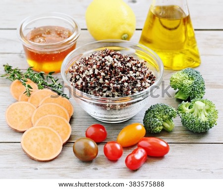 Quinoa salad with sweet potatoes,broccoli and tomatoes.Ingredients.Superfoods concept.Healthy eating. - stock photo
