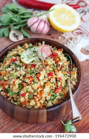 Quinoa salad with vegetables mix,lemon and thyme. - stock photo