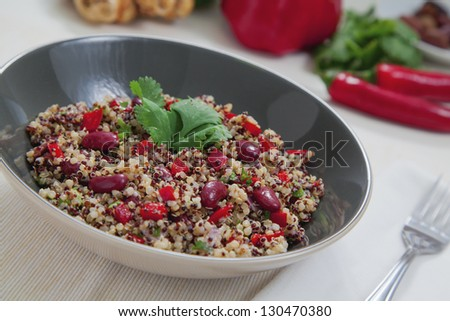 Quinoa salsa with capsicum, onions and beans - stock photo
