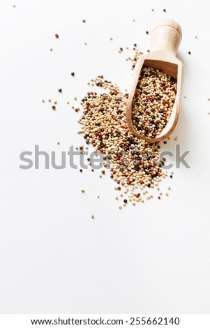 quinoa seed grain in a wooden bowl scoop  - stock photo