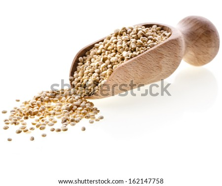 quinoa seed grain  in a wooden bowl scoop close up isolated on a white background - stock photo