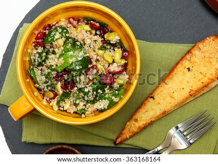 Quinoa Spinach Cranberry Salad and Garlic Toast on Table. Above top view.