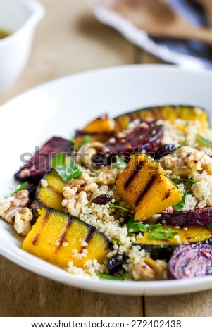 Quinoa with grilled pumpkin and beetroot salad by vinaigrette - stock photo