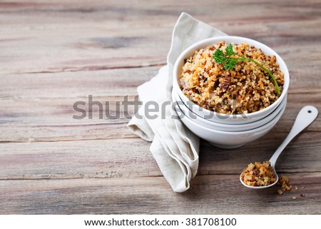 Quinoa with mushrooms and vegetables, selective focus - stock photo