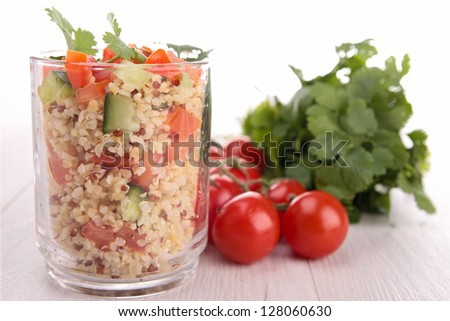 quinoa with tomato and cucumber - stock photo