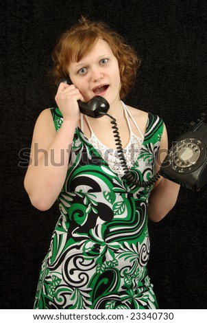 Quirky girl talks on rotary phone