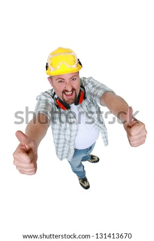 Quirky handyman giving two thumbs-up - stock photo