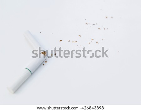 Quit smoking concept, cigarette butt with ash isolated on white background  / soft focus - stock photo