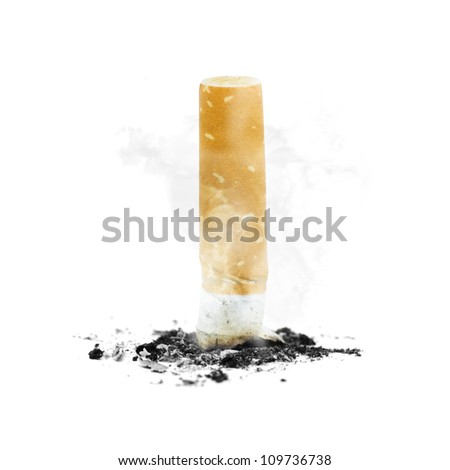 Quit smoking concept with a cigarette butt stubbed out amidst ash and smoke on white background - stock photo