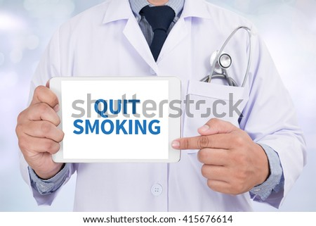 QUIT SMOKING Doctor holding  digital tablet - stock photo