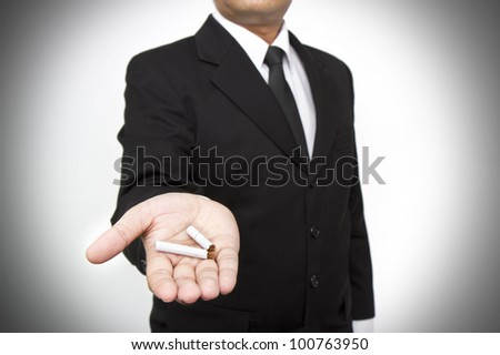 Quit smoking, human hands breaking the cigarette