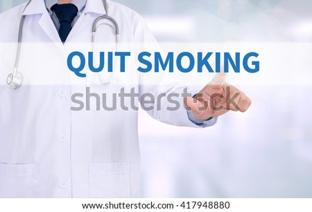 QUIT SMOKING Medicine doctor working with computer interface as medical - stock photo