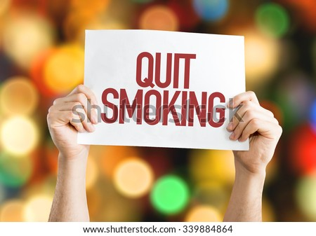 Quit Smoking placard with bokeh background - stock photo