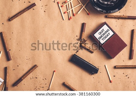 Quit smoking today concept, broken cigarette on table. - stock photo