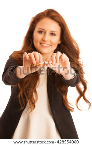 quit smoking - woman breaking cigarette isolated over white background - stock photo