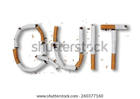 Quit smoking word written with broken cigarette concept for quitting smoking - stock photo
