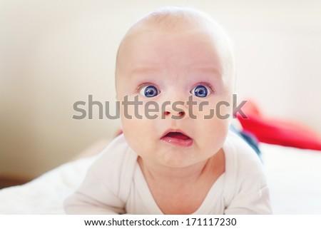 Quite extraordinary portrait of baby - stock photo