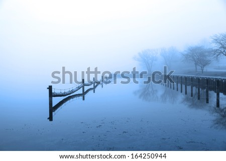 Quite lake in winter time - stock photo