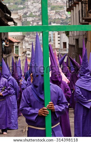 QUITO, ECUADOR - APRIL 22, 2011: Faaithful catholics participating in the Holy week procession