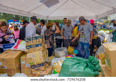 Quito, Ecuador - April,17, 2016: Unidentified people in Quito providing disaster relief food, clothes, medicine and water for earthquake survivors in the coast