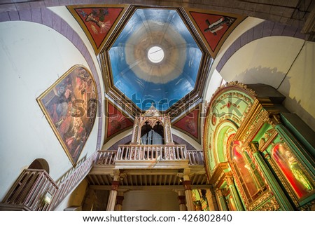 QUITO, ECUADOR - AUG 25: Interior of the cathedral in old town on August 25, 2014 in Quito, Ecuador.