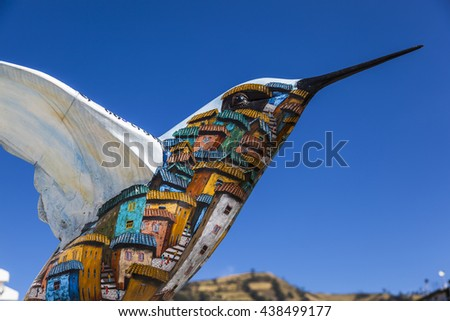 Quito, Ecuador - August 25, 2015: Hummingbird sculpture, painted by visual artists in the park colibries in the city in Quito.