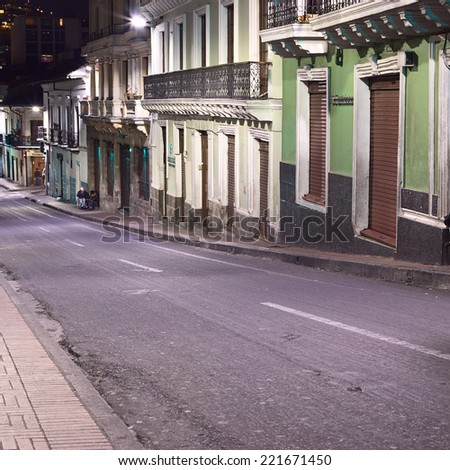 QUITO, ECUADOR - AUGUST 8, 2014: Venezuela street in the historic city center photographed at night on August 8, 2014 in Quito, Ecuador. Quito is an UNESCO World Cultural Heritage Site.  - stock photo