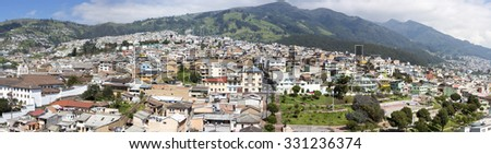 QUITO, ECUADOR, FEBRUARY 24: Panorama of Quito with residential colonial houses in the mountain during the day with a blue sky. Ecuador 2015. - stock photo