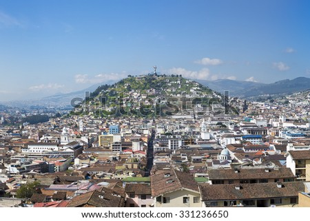 QUITO, ECUADOR, FEBRUARY 24: Panorama of the capital of Quito during the day with the Panecillo and the old colonial section of the city. Quito is the first UNESCO Heritage site. Ecuador 2015 - stock photo