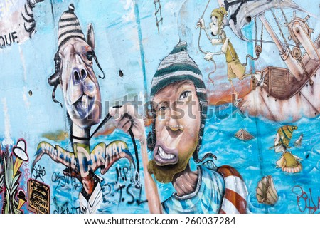 QUITO, ECUADOR - JAN 1, 2015: Graffiti on a house of the historic center of Quito. Historic center of Quito is the first UNESCO WOrld Heritage site - stock photo
