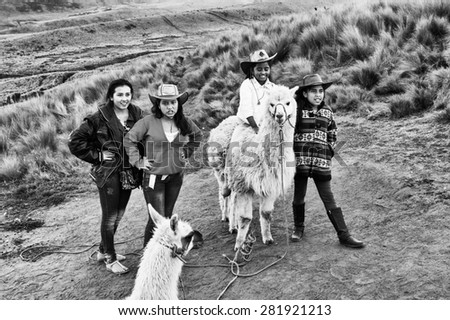 QUITO, ECUADOR - JAN 2, 2015: Unidentified Ecuadorian girls with lama . 71,9% of Ecuadorian people belong to the Mestizo ethnic group